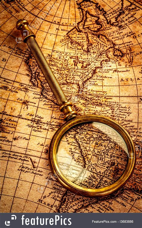Vintage Magnifying Glass Lies On An Ancient World Map Photo